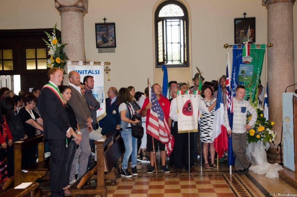 I nostri Emigranti con le bandiere degli Stati dove risiedono